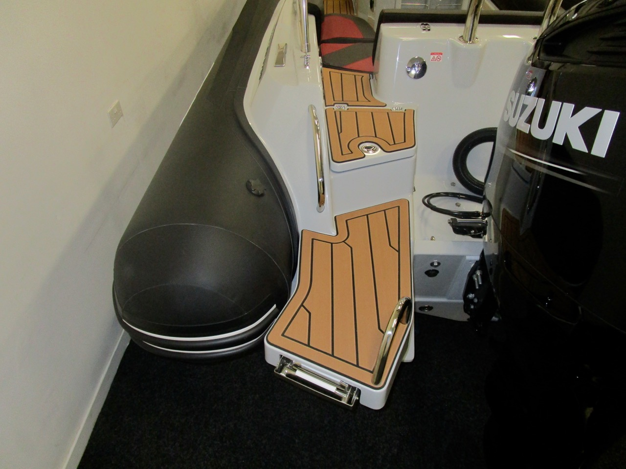 GRAND G750 RIB stepped access to cockpit from bathing ladder