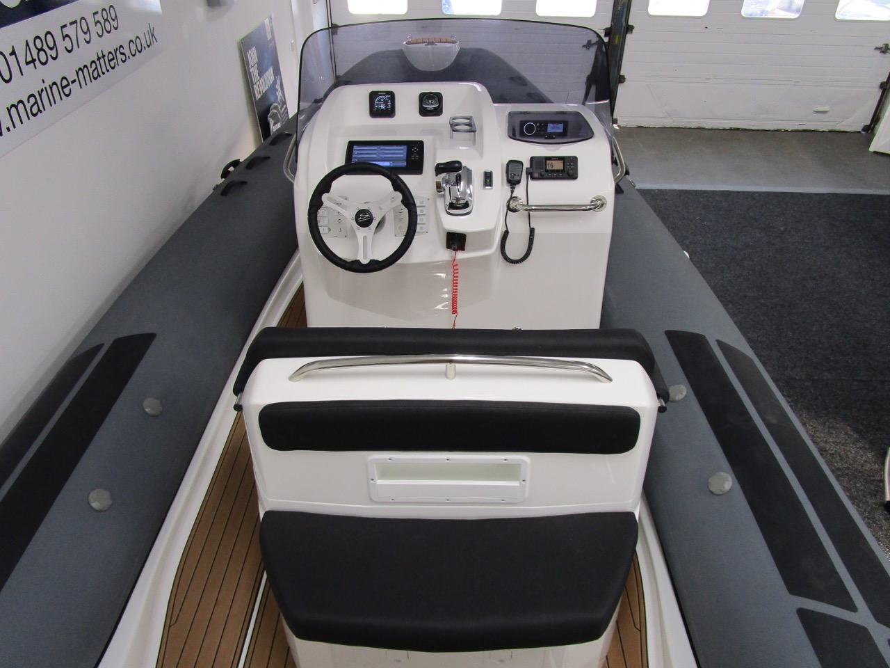 E780 - Rear facing seat on back of helm seat