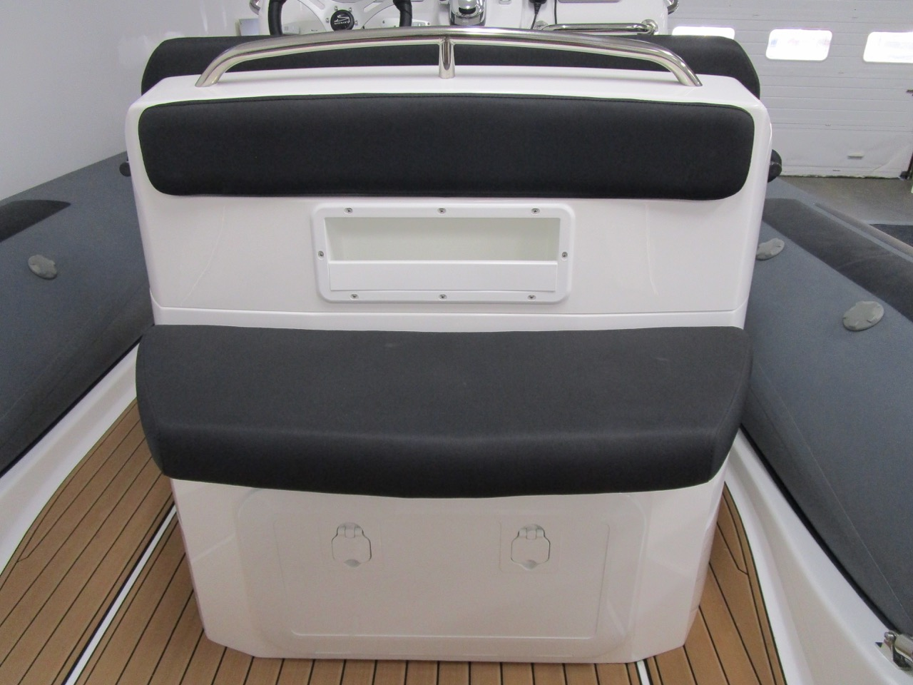 E780- Rear facing seat on reverse of helm seat